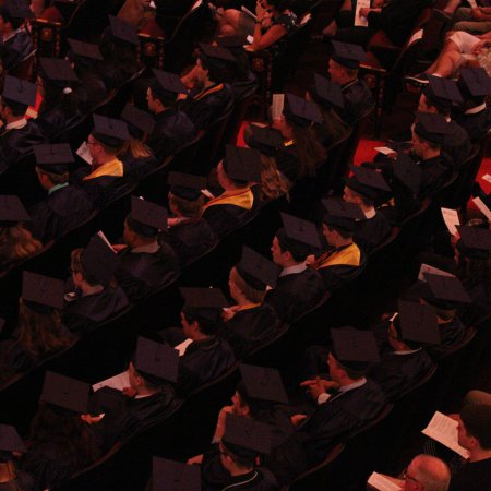 View from above of graduates in caps and gowns