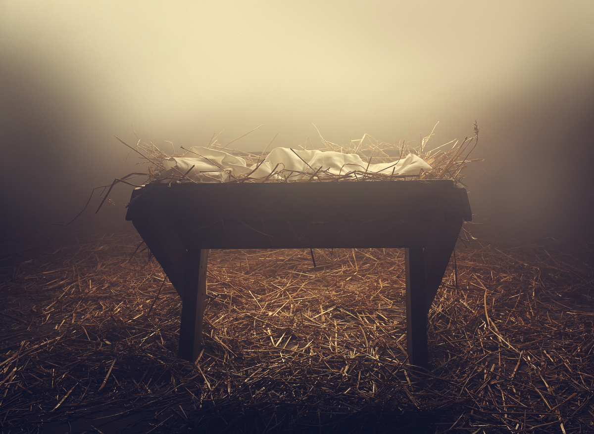 simple manger in a foggy glow